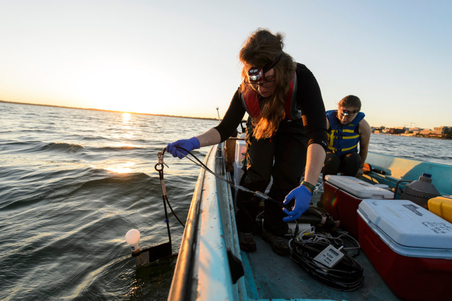 Graduate students studying water resources engineering and science, collect data and water samples from Lake Mendota near the University of Wisconsin-Madison campus