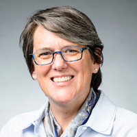 Studio portrait of Jenny Faust, associate vice provost for Strategic Initiatives and director of the Office of Quality Improvement and Administrative Process Redesign at the University of Wisconsin-Madison
